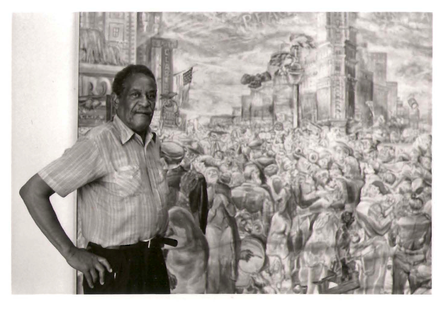Joseph Delaney stands with his painting VJ Day
